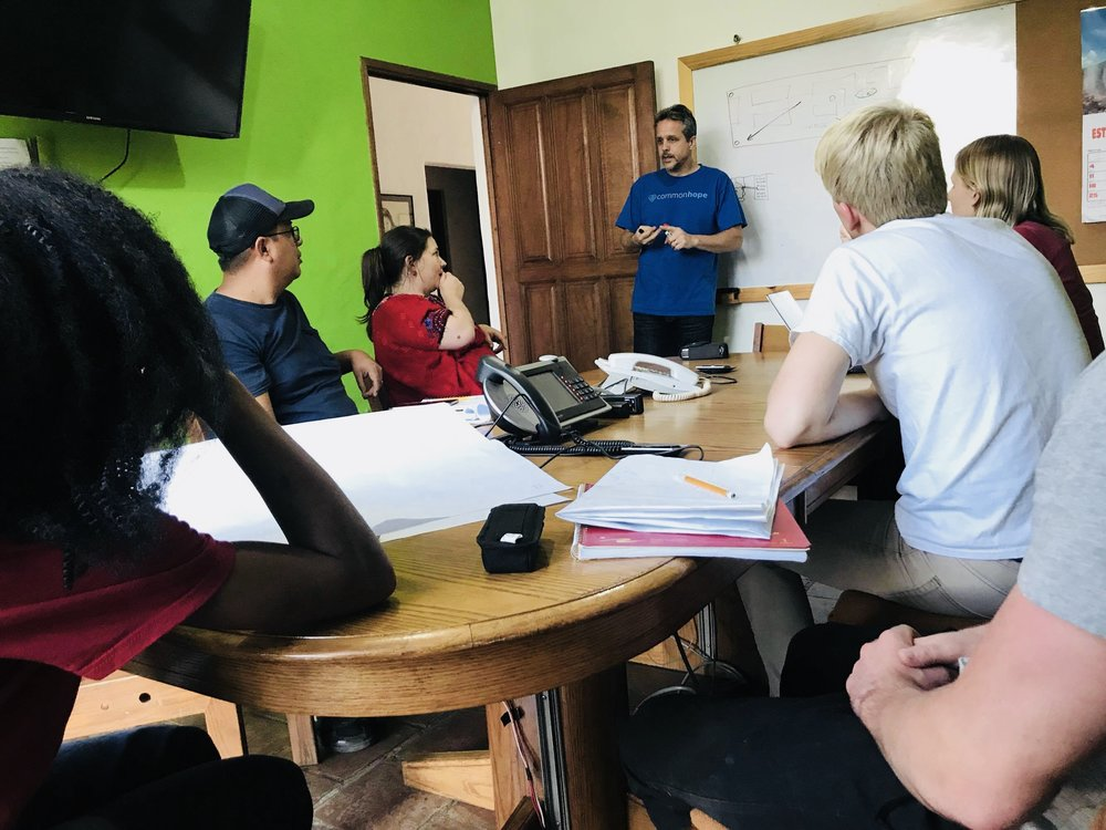 Travel team members discussing with mentor Peter Kraut during the February 2018 assessment trip in Antigua.