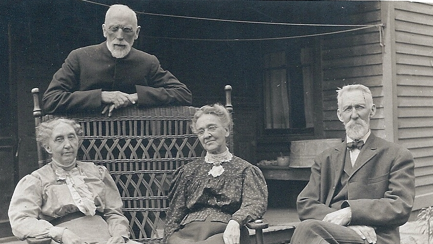 L.W. Applegate (standing) and his wife Rebecca (seated, left), return to New Lenox in 1912 for his second non-consecutive term as rector of Grace. Here they are seated with friends on the porch of the parsonage. This photo was taken in 1913.