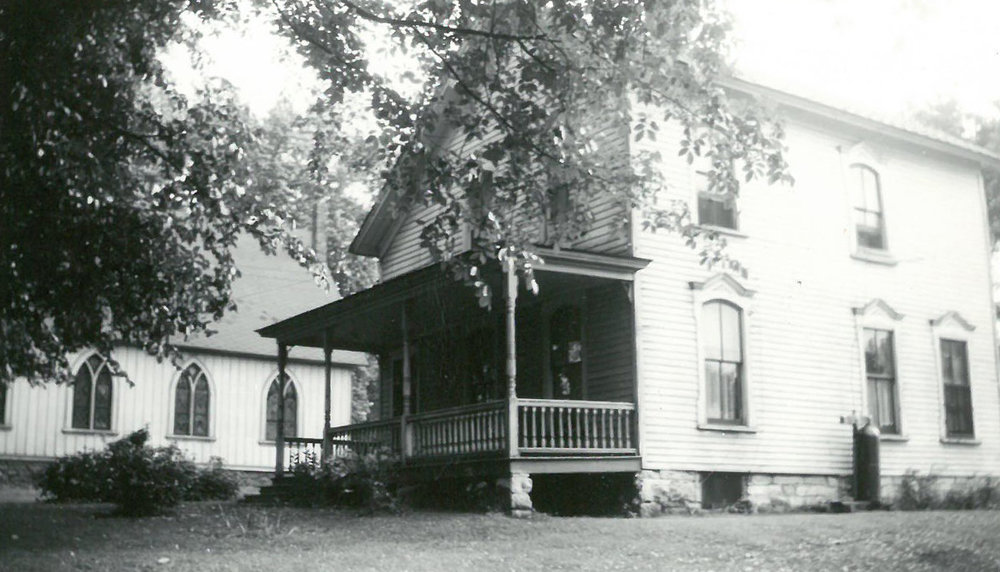 """The former parsonage (""""rectory"""") to the north of the church (the sanctuary is visible on the left). Photo ca. 1940s."""