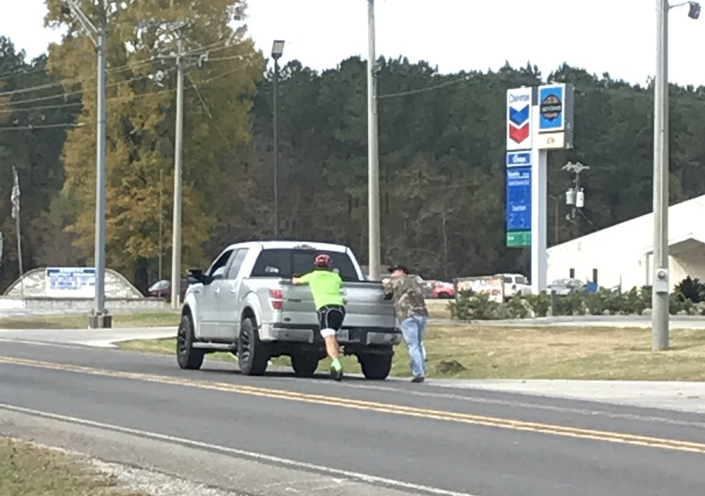 Dad helped local push there truck to the gas station after it ran out of gas.