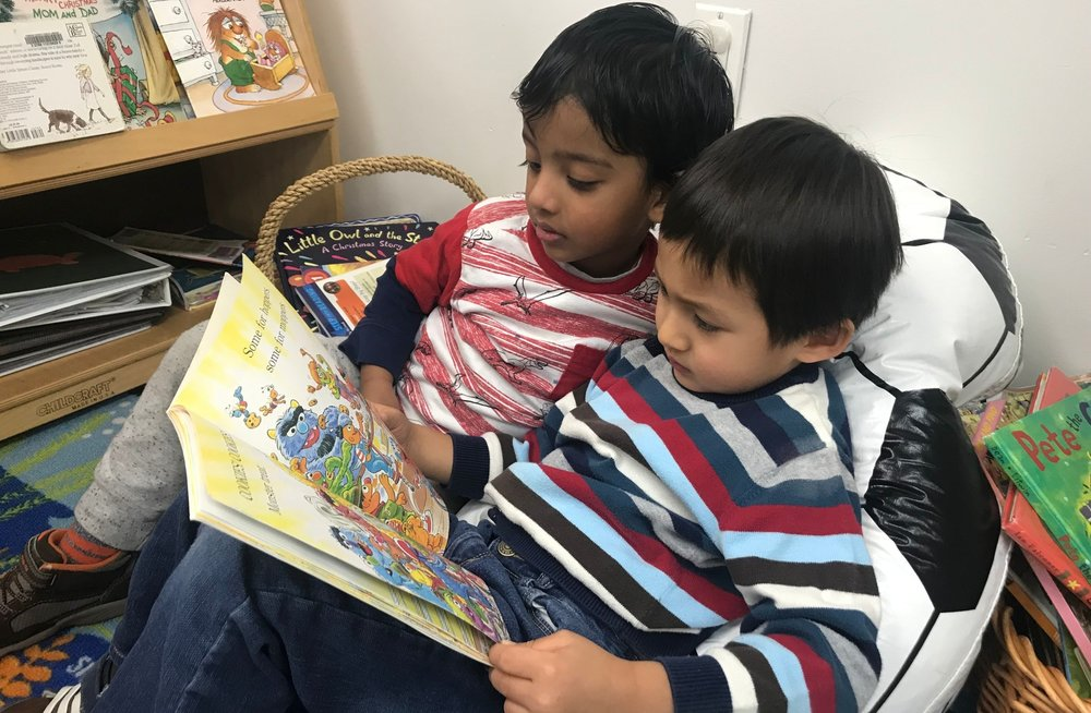 "Early Literacy - At King of Kings children hear stories, participate in dramatic storytelling, and are encouraged to ""read"" books to themselves in their classroom library. Each class engages in a weekly lending library to foster their love of books!"