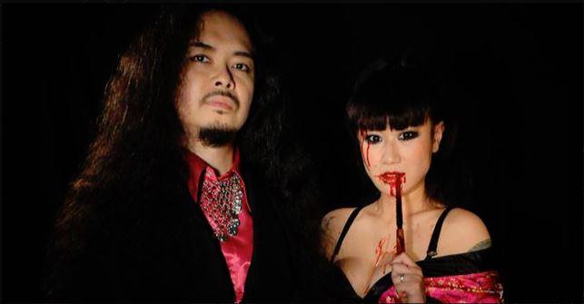 SIGH is Mirai Kawashima - Vocals, Keyboards, Orchestrations etc. [pictured], Dr. Mikannibal - Alto, Tenor, Baritone Saxophones, Vocals [pictured], Satoshi Fujinami - Bass, Drums, You Oshima - Guitar and Junichi Harashima - Drums