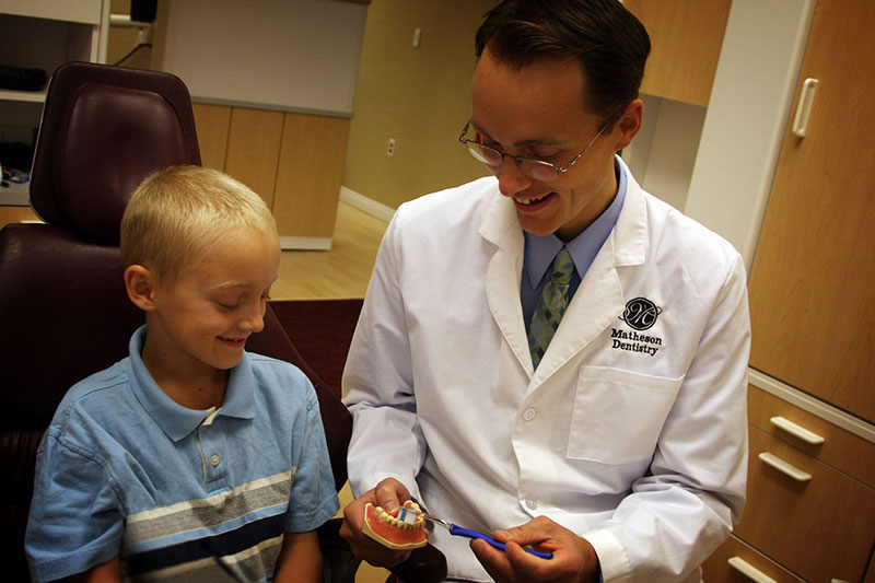 Matheson With Child and dentures.jpg