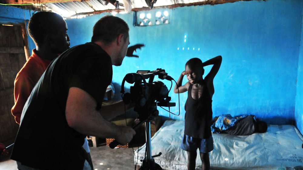 Banker White with WeOwnTV at work in Sierra Leone