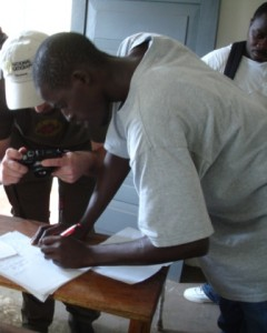 Banker documents the signing of the lease by Arthur Pratt, manager of WeOwnTV: Sierra Leone.