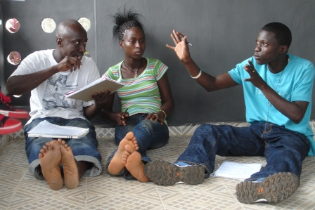 Frank T.O. M'Cormack, Kanku Thoronka and Ernest Sesay of Group Two in story discussions.