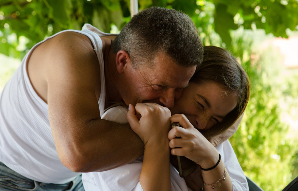 "Bashkim Ujkani hugs his daughter, Abide, after arriving home at the end of the day in Venarc, Kosovo on July 4, 2017. ""My dad was always teaching me to be a girl that respects each other no matter if that is a boy, a girl, Serbian, Albanian, Bosian, or whatever, He [taught] me that I need to respect them for who they are."""