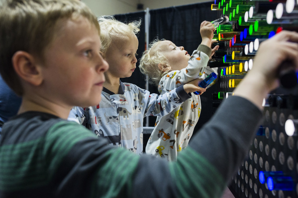 Jacob, 6, Garrett, 2, and Cameron Boland, 2, play at the Giant Light Bright at Rochester Institute of Technology during Imagine RIT on May 6, 2017. The Imagine RIT: Innovation and Creativity Festival is an annual event that showcases the achievements of RIT's community through performances, interactive exhibits, and presentations.