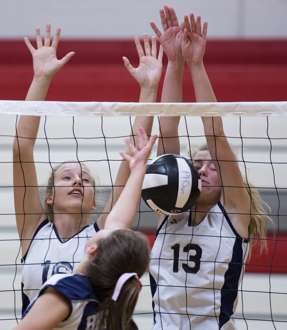 A Brighton volleyball player hits a ball into the net during a game against the Bayport-Blue Point Phantoms at the Penfield Varsity Volleyball Tournament on September 2, 2017 in Penfield, N.Y.