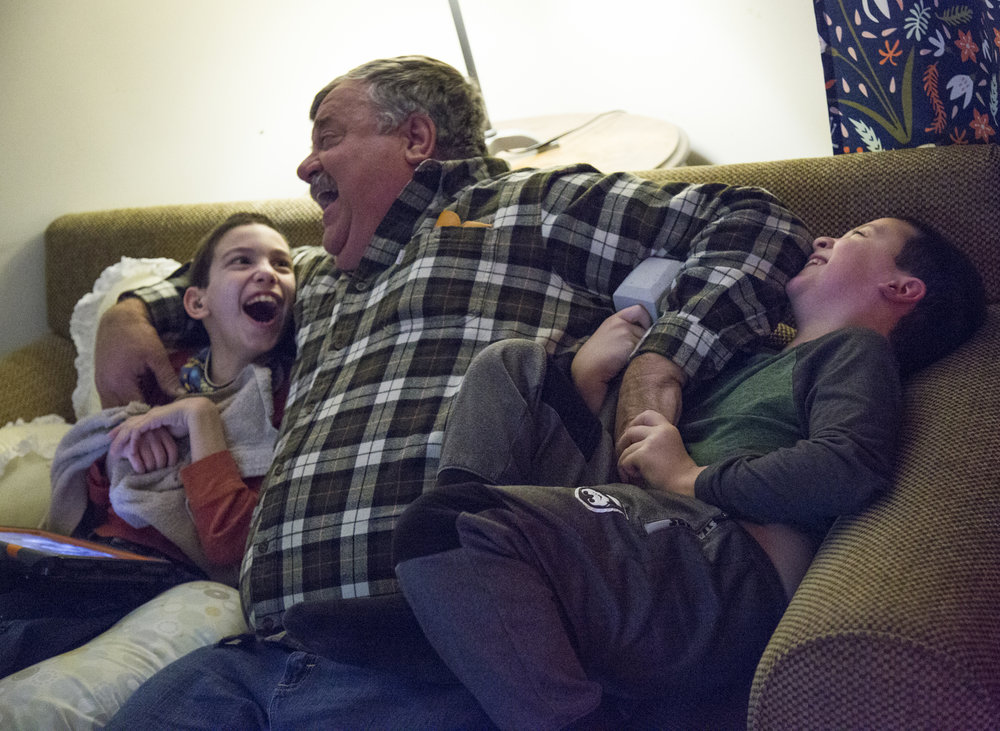 Josh, 9, and his brother Caleb, 7, play with the grandfather at their home on Dec. 13, 2017. When they were younger, the boys rarely played together, but now that Caleb is older, they are beginning to have more of a relationship.