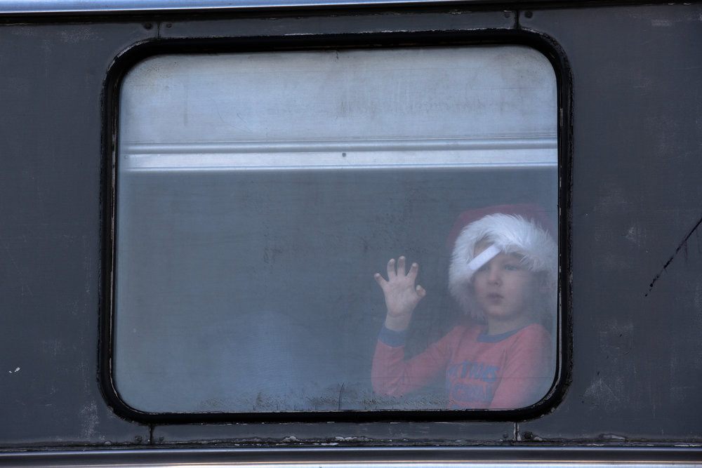 A child looks out the window of a train at the Medina Railroad Museum during the Polar Express Event on Dec. 2, 2018 in Medina, N.Y.