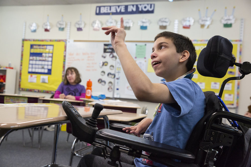 Joshua, 10, signs to his teacher during a lesson on Veterans Day on Nov. 10, 2018.