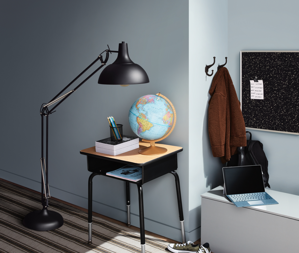 a vignette of a room decorated in tones of light pine and black, with an academic vibe