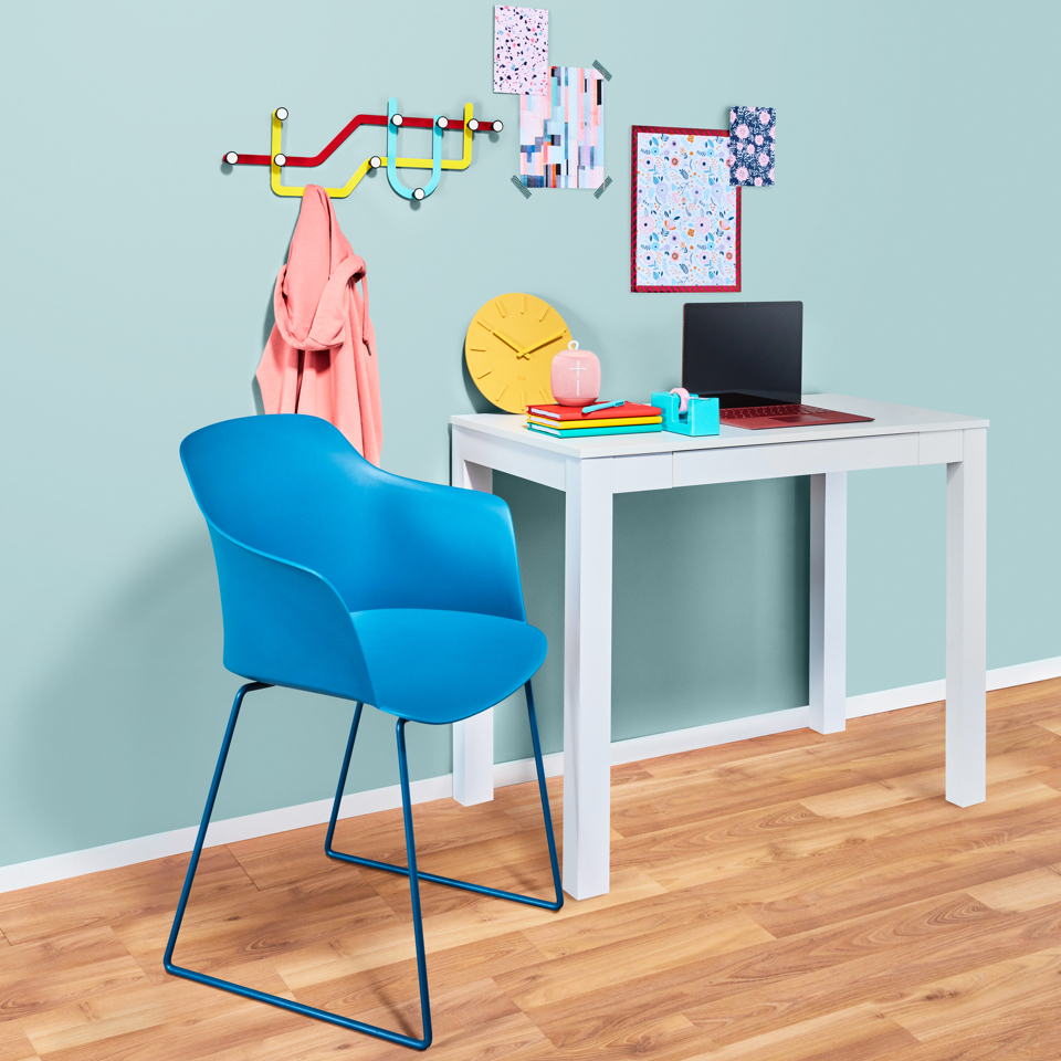 a vignette of a room decorated in tones playfrul, bright, pastel colors