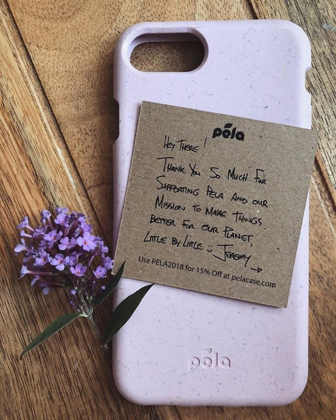 Lavendar case on top of aged wood beside a sprig of Lavendar flower