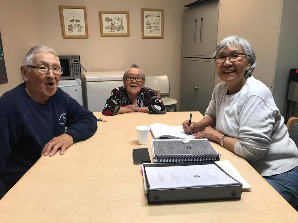 Inuinnnaqtun specialist Gwen Angulalik working with Elders Jimmy and Margaret Okhina on 100 year old word list.