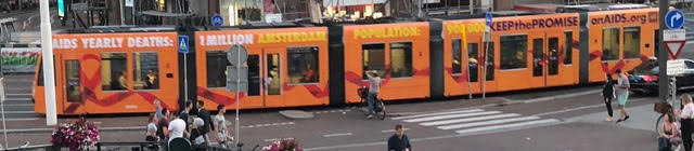 """Amsterdam trams said - """"AIDS Yearly Deaths: 1 million - Amsterdam population: 900,000. Keepthe   PromiseOnAIDS.org   """" The Dutch people are very welcoming...!!!"""