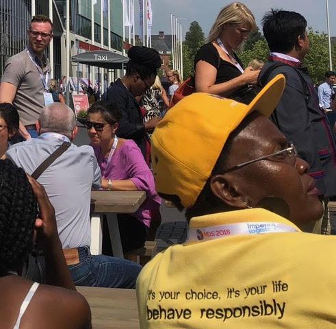 Message on yellow shirt. Michael Lecker surveys the crowd far left.