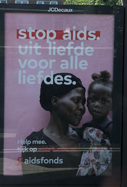 Sign at a transit stop reflects a global perspective.