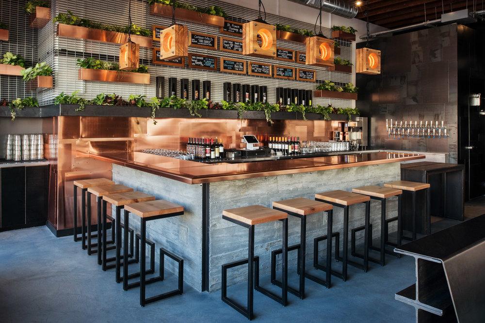 Encontro restaurant bar, Encontro seating, copper counter, copper building details, interior design