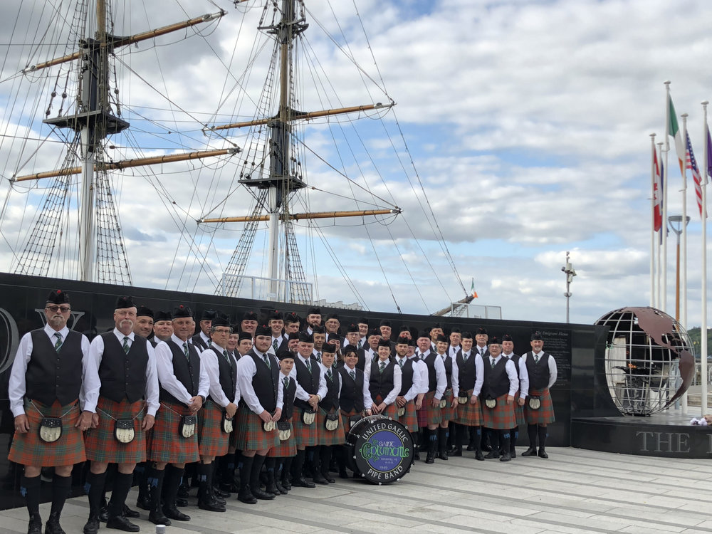 St. Columcille United Gaelic and Columcille School of Piping & Drumming pose before the Dunbrody Emigrant Ship and Museum in New Ross, Co. Wexford, Ireland.