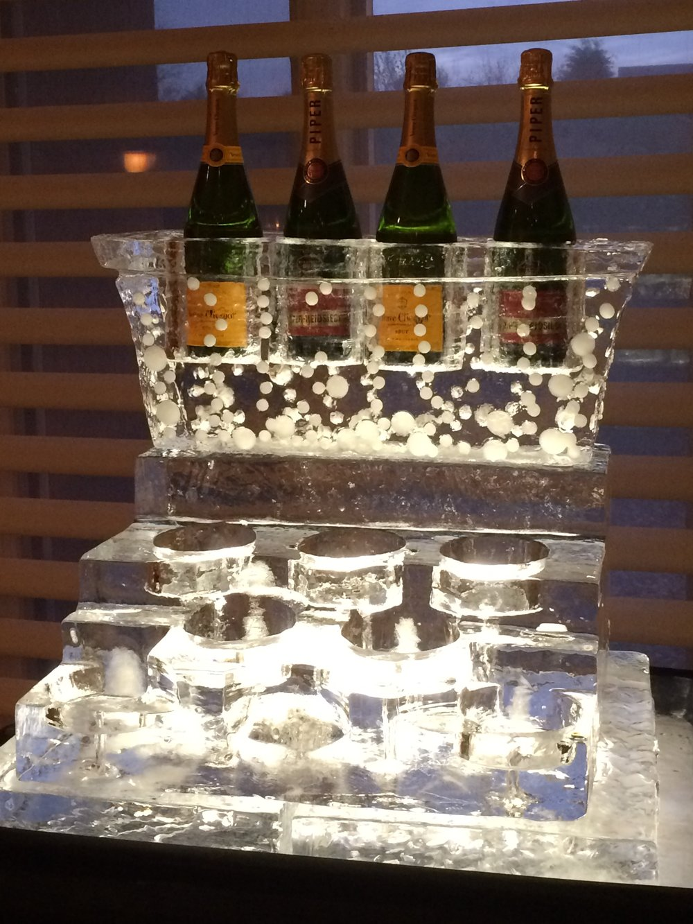 Wine bottles chill on the top row of this multi tiered bottle holder. Lower tiers can be carved out in a circle to accommodate more bottles or be carved rectangular to accommodate a food tray.
