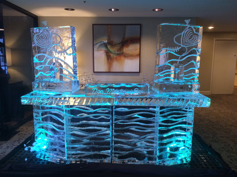 This full sized bar is made of 7 blocks of ice. Installed with a drip tray and drainage, it can provide all-night functionality...and attracts many more guests than a regular bar