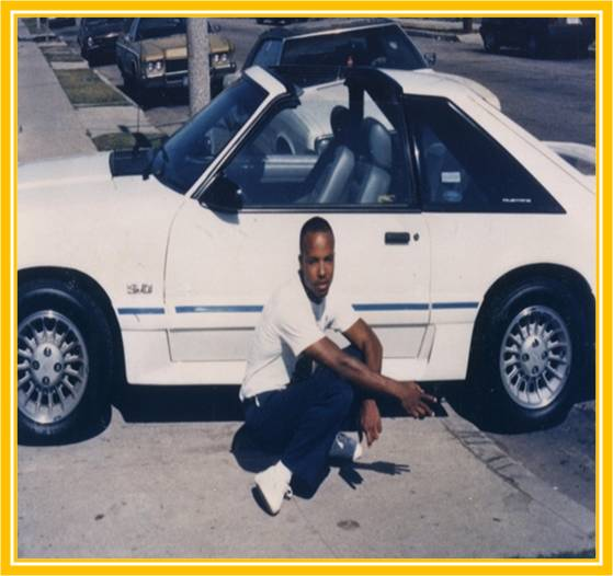 Pierre Romain in front of the white Mustang