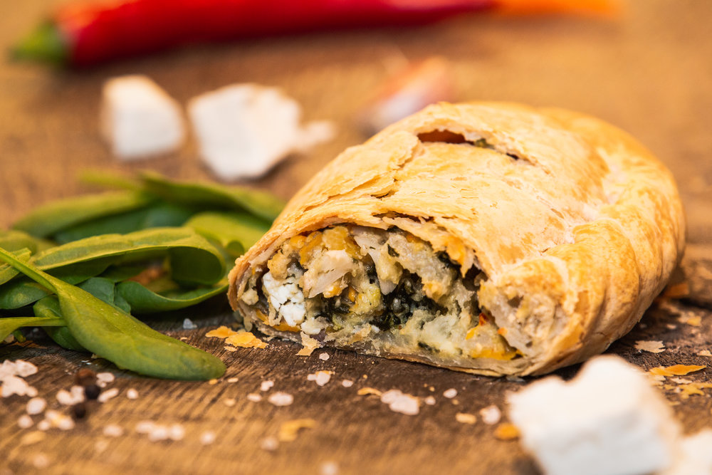 A wide variety of authentic Cornish pasties for meat fans, veggie lovers and vegans. This one is butternut squash, spinach and feta. Perfect for eating in and taking away.