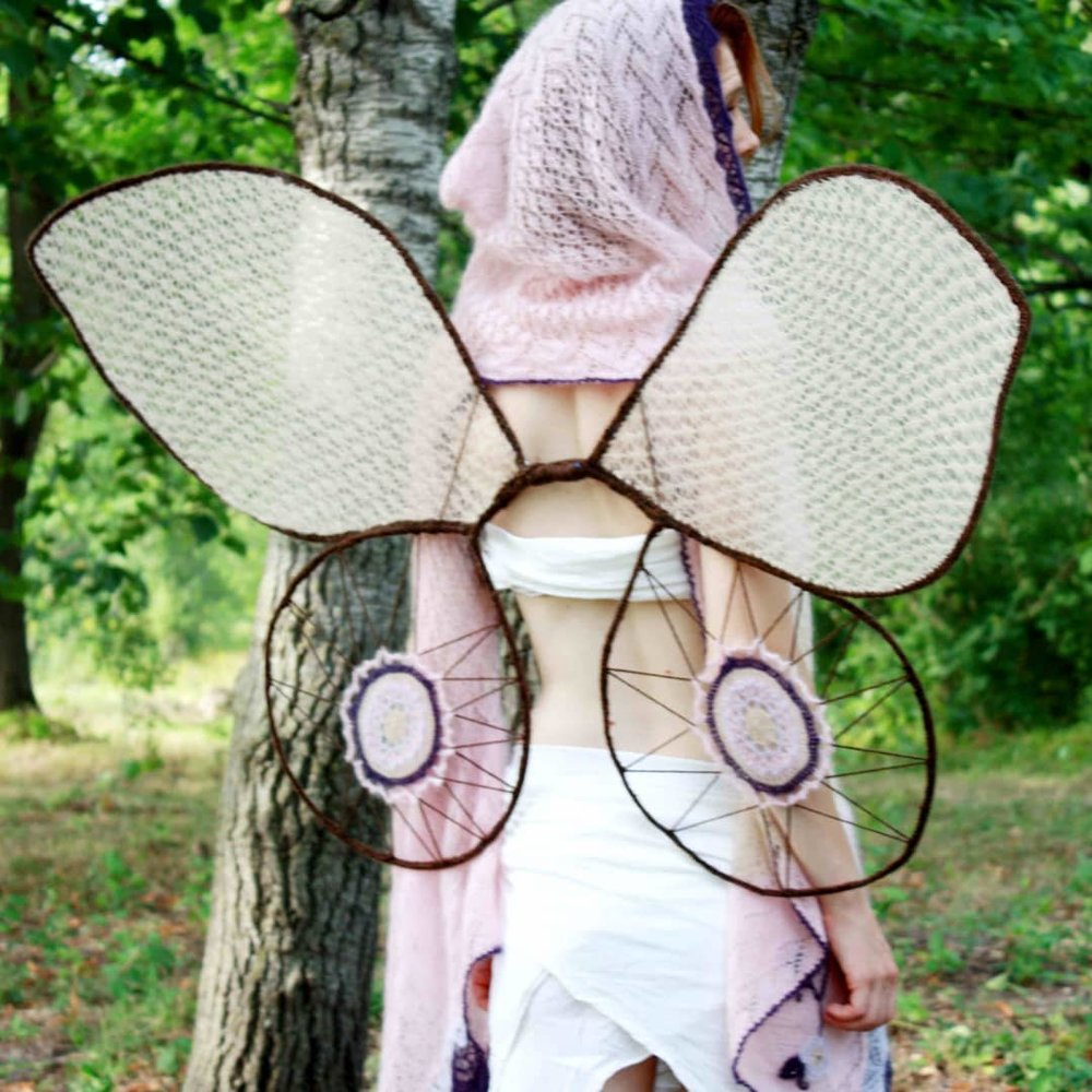 Wing frames are made from fencing wire and electrical tape wrapped in spare yarn.
