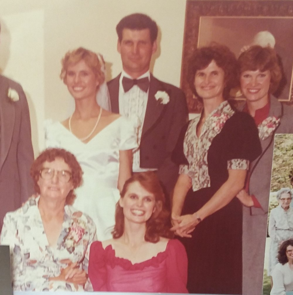 My mom is in the process of moving, and her wedding photos are not readily available. This is the only photo I have from her wedding right now. Here she is in her wedding dress with her mom (who made the dress), sisters, and brother.