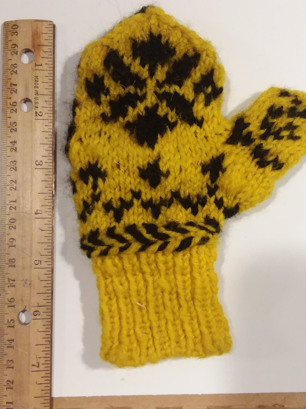 Here you can get an idea for gauge. You can also see that these mittens would benefit from some blocking.