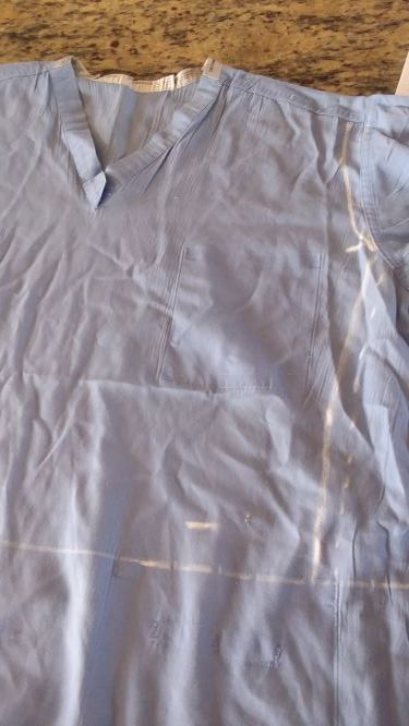 Scrub shirt with bodice drawn in.
