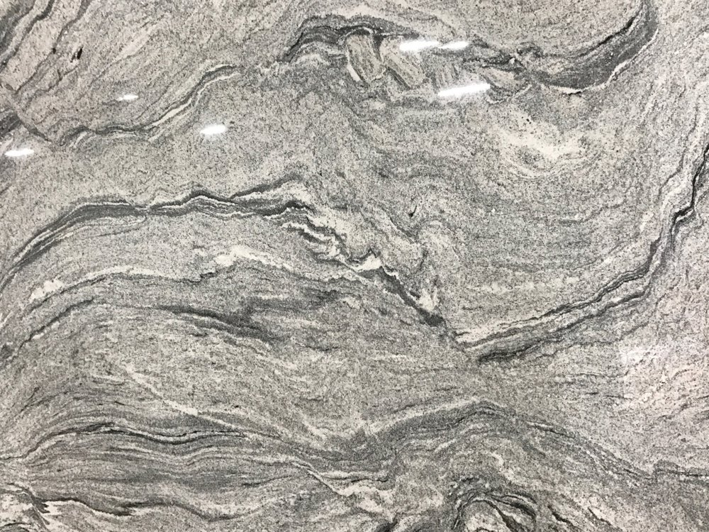 Vintage White - Quarried: IndiaMaterial Type: GraniteDescription: grey and white base color with black veining with sweeping clouds and waves.Other Name(s): Viscount White
