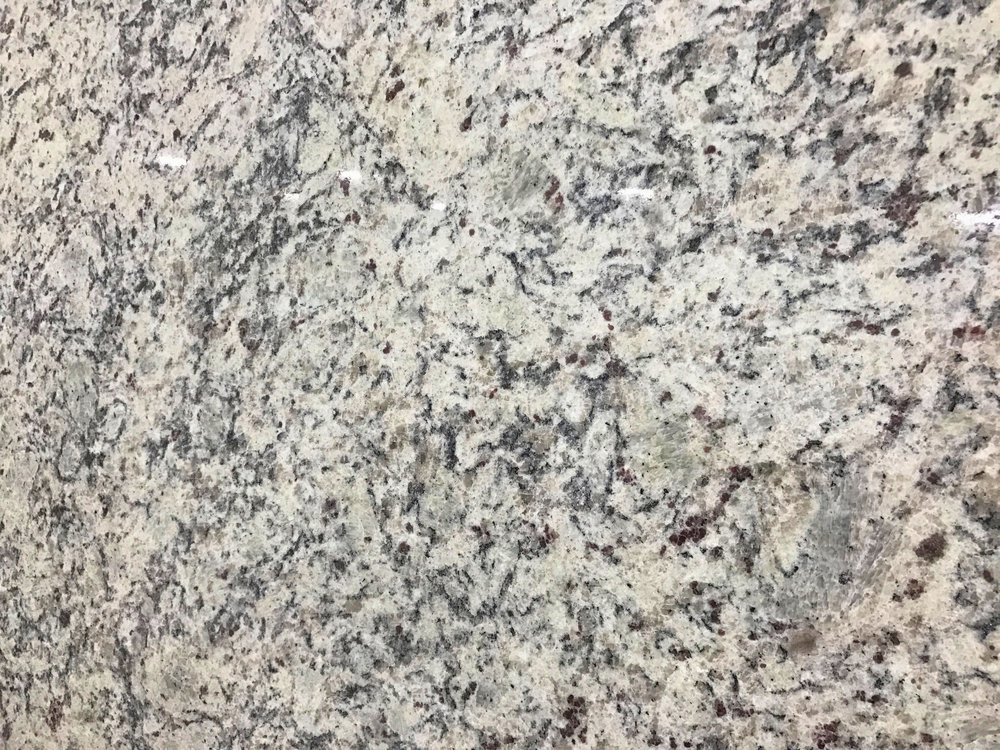 Dallas White - Quarried: IndiaMaterial Type: GraniteDescription: grey and white base color with black veining with sweeping clouds and waves.Other Name(s): Aspen White