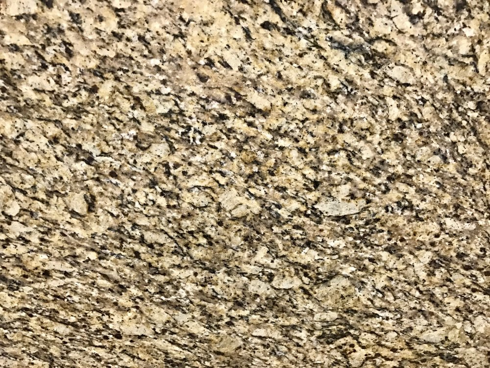 Venetian Pearl - Quarried: BrazilMaterial Type: GraniteDescription: cream base coloring with a patterning of speckle golden dark brown, yellow, black, taupe and white particles.Other Name(s): Venetian Ice, Venetian Gold