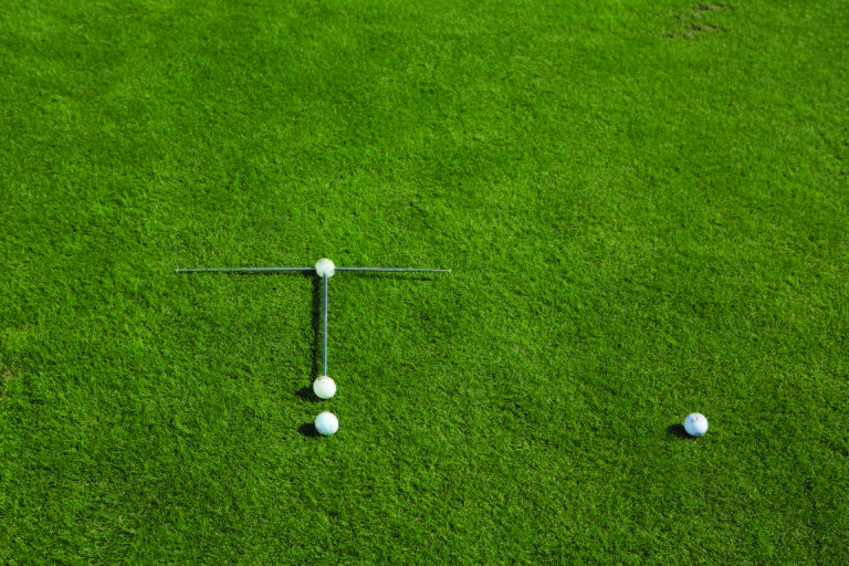 Sand & Flop Shots. - Set up Swing Station in the sand trap or on the ground for a slightly open stance.