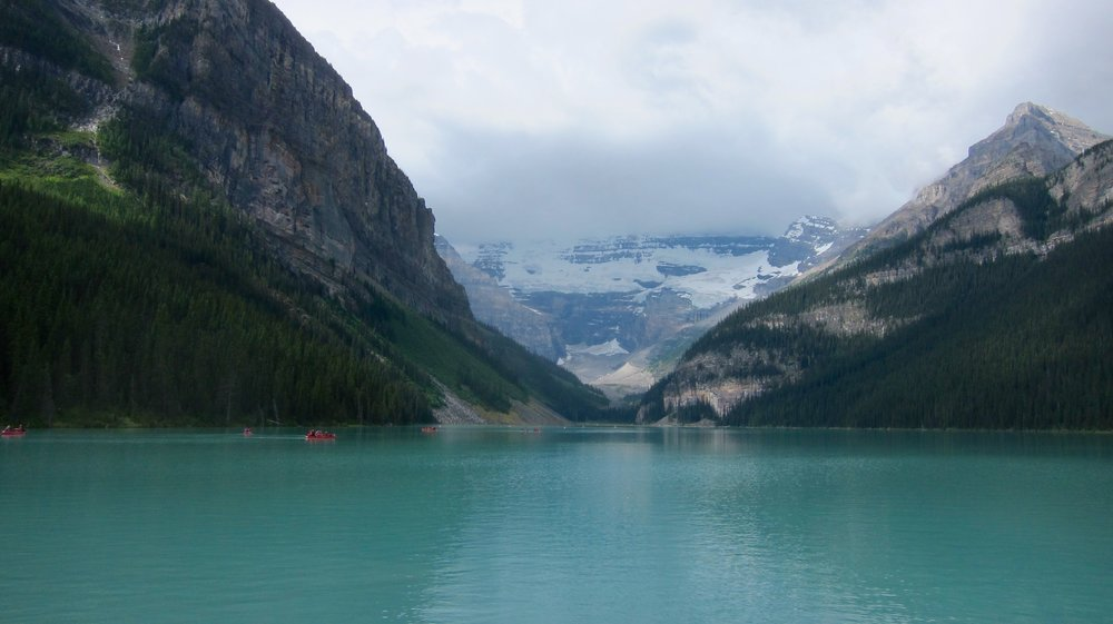 Canoes on Lake Louise with a glacier backdrop. Stunning!