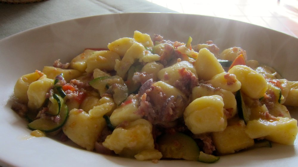 Gnocchi with a sausage, zucchini and tomato sauce. The lightest gnocchi I have ever tasted - so good!