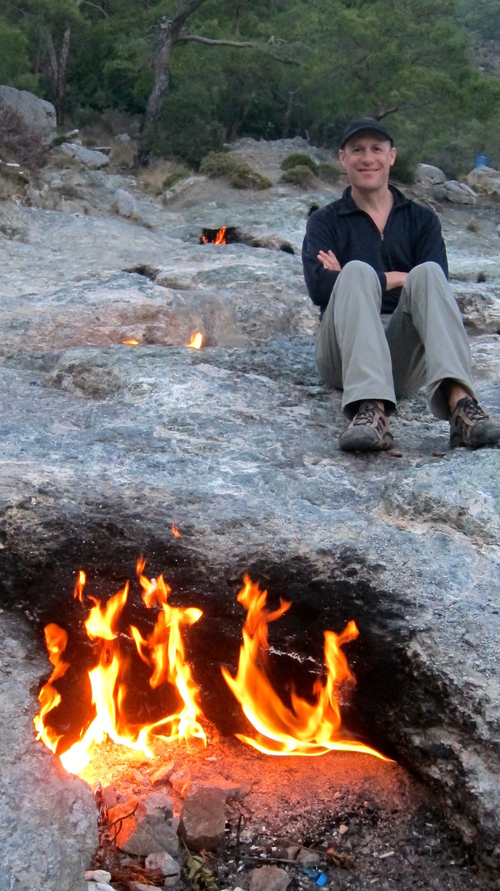 Dave sitting among the eternal flames of Chimera in southern Turkey.