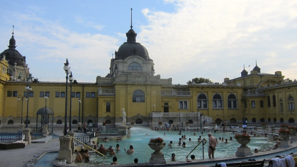 Beautiful buildings and warm pools at the baths in Budapest.