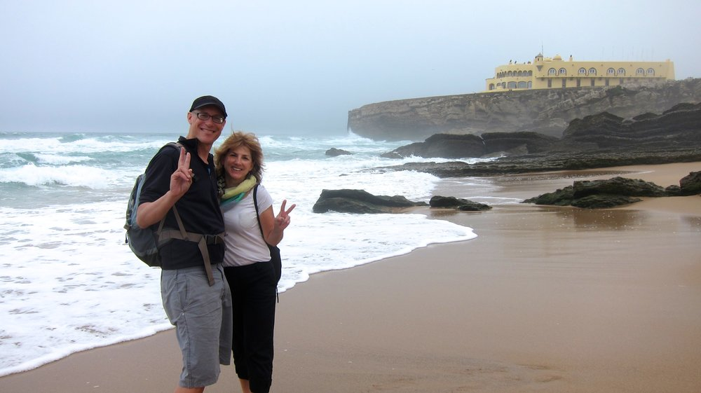 Dave and our friend Tracey at a beach stop on our bike ride from Cascais.