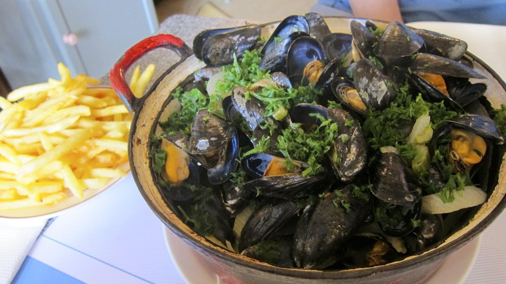 Our huge pot of mussels with a side of fries.