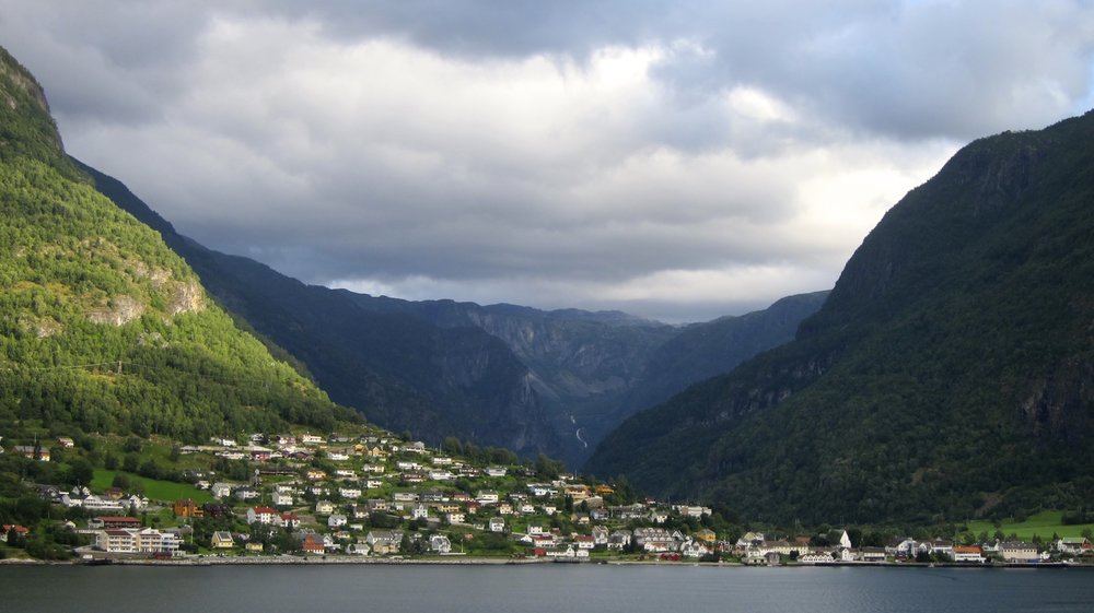 The view of a neighboring town while exiting the fjord in Flam.