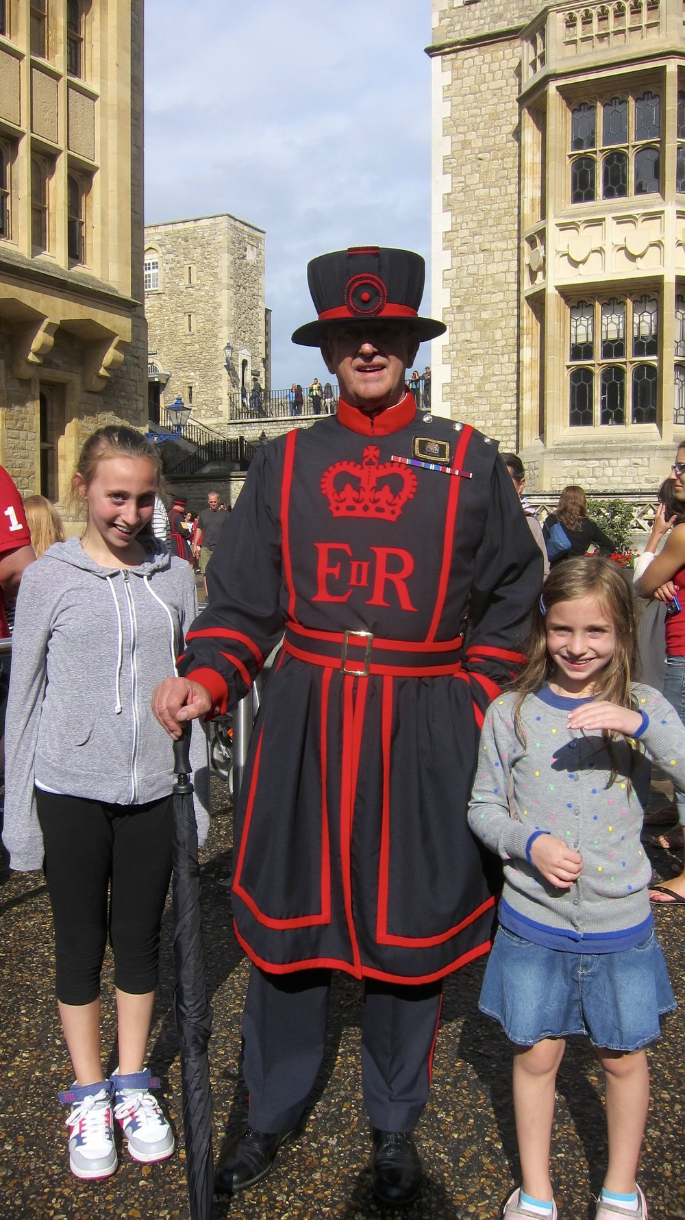 Anna and Sloane with a Beefeater at the Tower of London.
