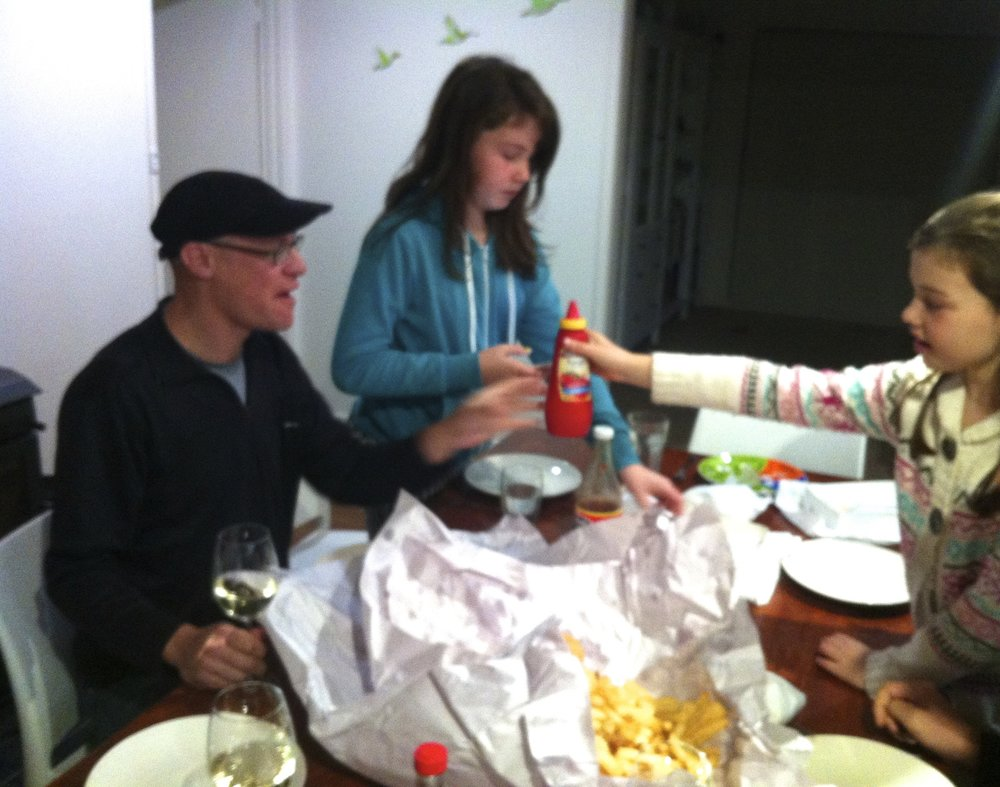 Family dinner over fish and chips.