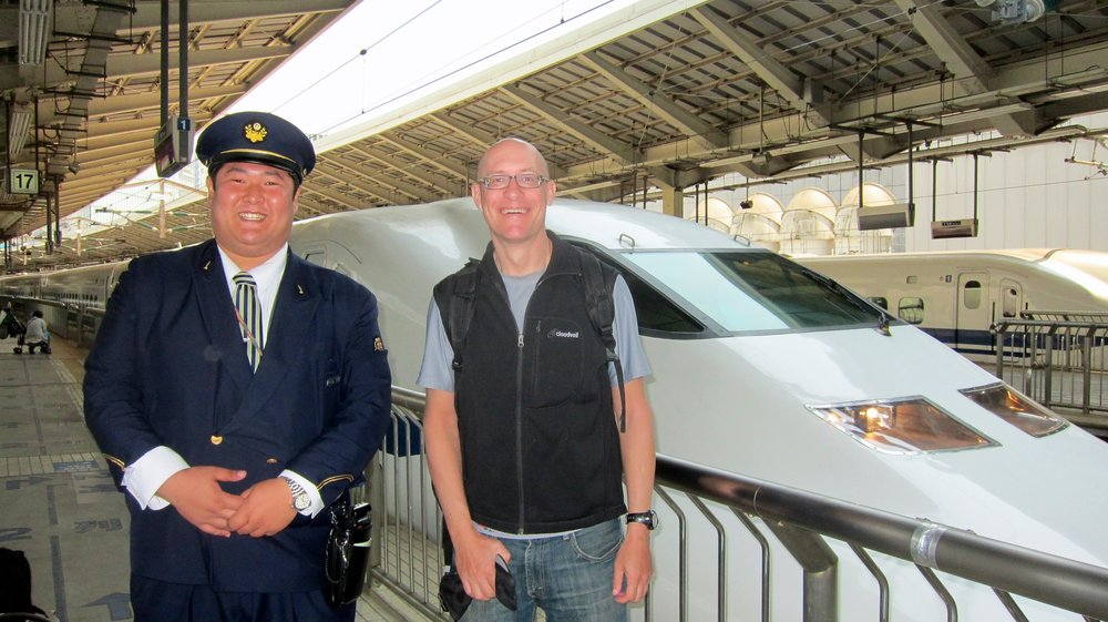 A happy Dave and a happy train conductor.