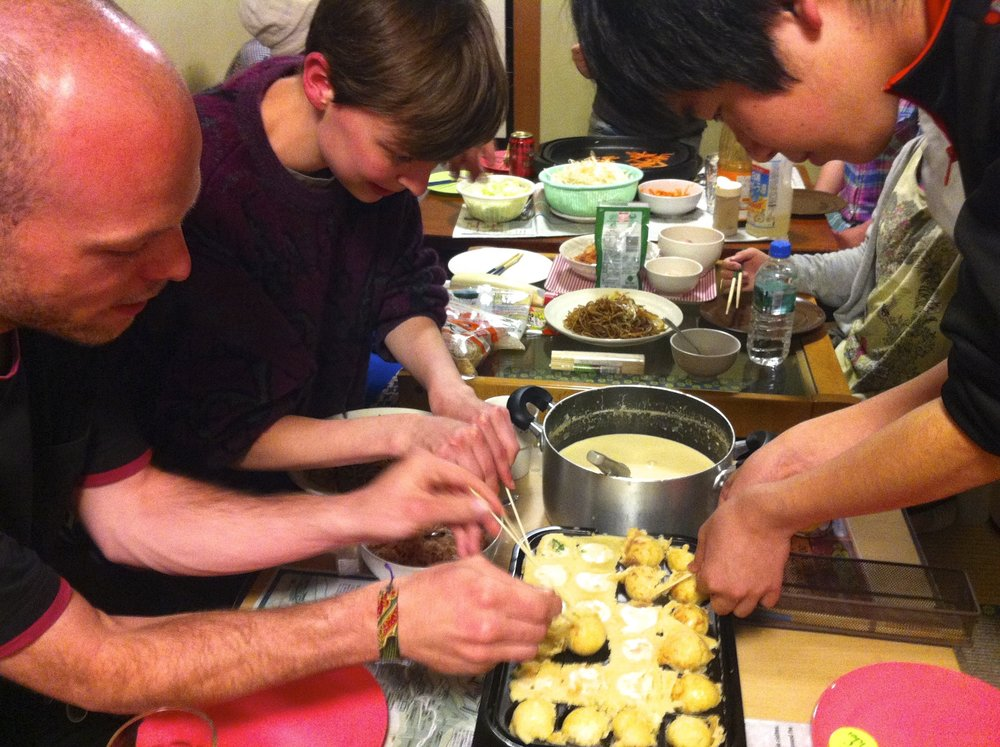 The group hard at work flipping takoyaki.
