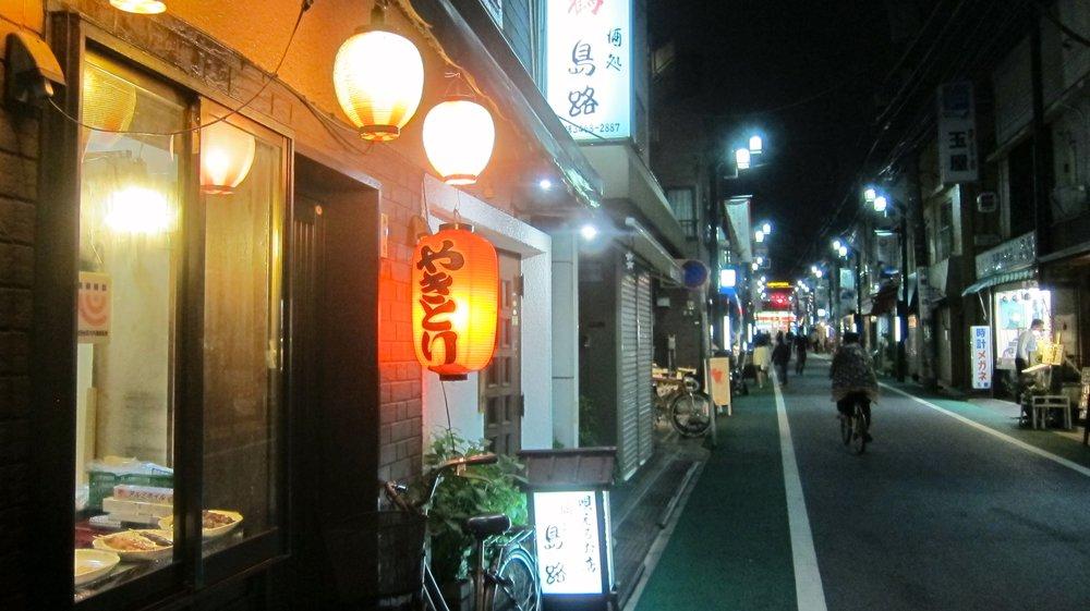 The tiny streets of Shimokitazawa at night.