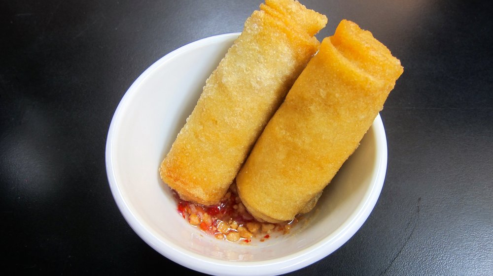 Fried spring rolls with sweet and sour sauce.